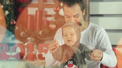 Dad plays with laughing baby dressed as a deer Stock Footage