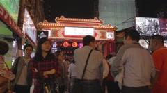 Entrance of Raohe night market - pan christmas lights Stock Footage