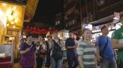 Family eating snacks - Raohe night market Stock Footage
