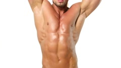 Muscular and sexy torso of young man, bodybulider isolatedon white Stock Footage