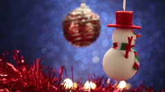 Christmas ball and snowman on glitter blue background Stock Footage