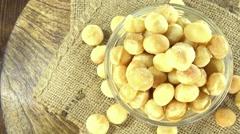 Rotating macadamia nuts (not loopable) Stock Footage