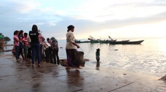 CRAB FISHING & SELLING - Wide shot of crab women by sea Stock Footage