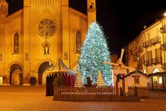 christmas tree in front of cathedral. alba, italy. - stock photo