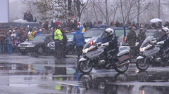 Police troops on motorcycles, cops in uniform march in line at parade, vehicles - stock footage