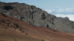 Horse riders in dead volcano Haleakala - stock footage