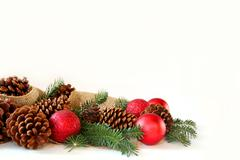 christmas bulb, pine cone, and evergreen border isolated on white background - stock photo
