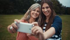 Mother and Daughter Take Selfie Together With Smart phone - stock footage