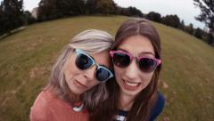Mother and Daughter Pose Silly With Sunnies For a selfie Stock Footage