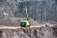 drill equipment in a open pit mine - stock photo