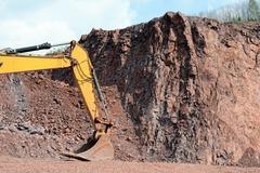 Earth mover shovel in a quarry Stock Photos