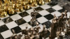 Chess, Silver Pawn moved forward (Greek Style Chessboard) - stock footage