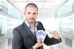 Casual man with lots of money at the office Stock Photos