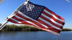 Motorboat and american flag Stock Footage