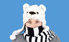 woman with funny bear hat - stock photo