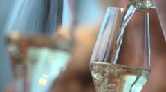 Couple in restaurant white wine by the glass Stock Footage