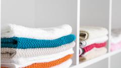 towels in the linen closet - stock photo