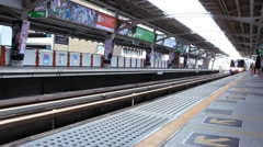 Thailand, Bangkok, 1 August 2014. Sky train station and passengers coming and Stock Footage