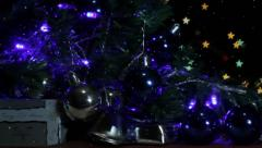 Christmas tree decoration with background lights dolly shot - stock footage