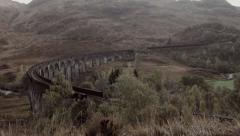 Harry Potter Hogwarts Jacobite Steam Train , Glenfinnan Viaduct Stock Footage