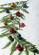 cedar branch with christmas balls - stock photo