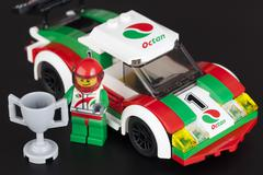 Lego race car and pilot with cup Kuvituskuvat