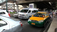 Thailand, Bangkok, 1 August 2014. Cars wait at a junction traffic congestion. Stock Footage