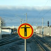 sign beware of trespassing at train station - stock photo
