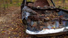 Motion Time-lapse of derelict old car in the forest Stock Footage