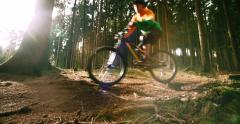 Mountain Biker Riding On Forest Trail in slow motion Stock Footage