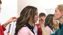 Make-up for beautiful model girl behind the scenes Stock Footage