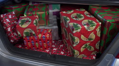 4K Dad Grandpa Unload Christmas Party Presents - stock footage