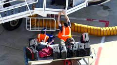 Airport baggage handlers, airplane gateway Stock Footage