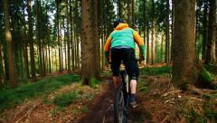 Mountain Biker going downhill with MTB slow motion Stock Footage
