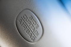 Airbag sign in the car - stock photo