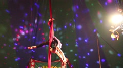 Girl spins on aerial silk in the circus 2 Stock Footage