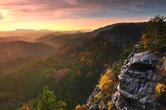 Sunset in a beautiful rocky park Bohemian-Saxony Switzerland. Sandstone peaks. Stock Photos