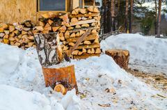 axe for firewood in winter - stock photo