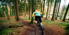 Mountain Biker starting to go downhill with MTB slow motion - stock footage