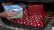Stock Video Footage of 4K Dad Grandpa Load Christmas Presents Into Trunk