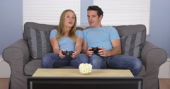 Couple in matching clothes playing video games Stock Footage