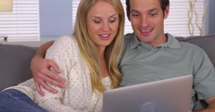 Couple looking for vacation getaway on laptop - stock footage