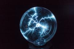 Electricity in a plasma ball Stock Photos