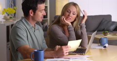Stressed couple dealing with too many bills - stock footage