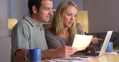 Couple having an easy time paying bills Stock Footage