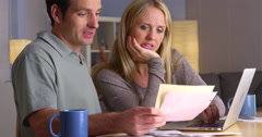 Couple feeling stressed over bills - stock footage