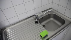 Man drying sink with towel HD Stock Footage