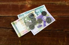 Swedish cash at an old red wooden plank Stock Photos