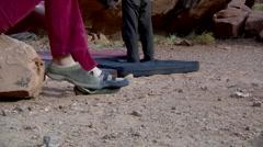Rock Climber Putting on Climbing Shoes Medium Stock Footage