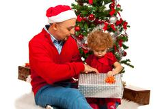 Father and daughter opening Xmas gift - stock photo